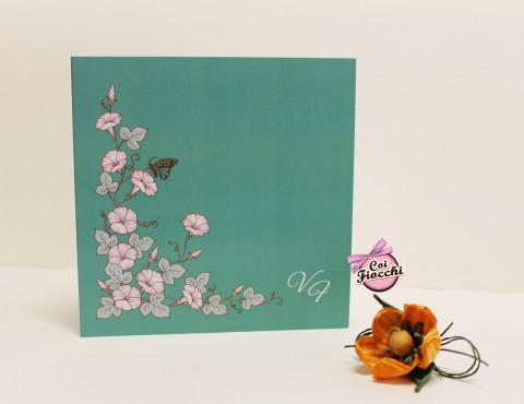 partecipazione di nozze boho chic con fiori e sfondo color tiffany