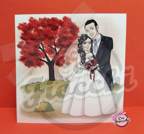 partecipazione nozze con caricatura manga degli sposi in primo pianto e albero della vita rosso passione in sfondo