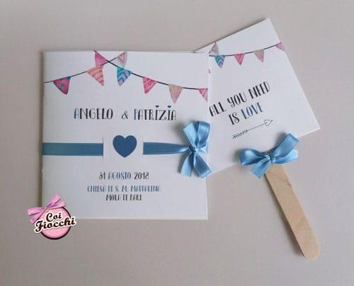 libretto messa simpatico personalizzato con festoni colorati e nastro di raso azzurro con cuore