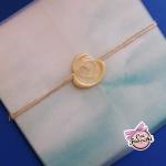 partecipazione nozze a tema mare in carta trasparente e ceralacca color oro