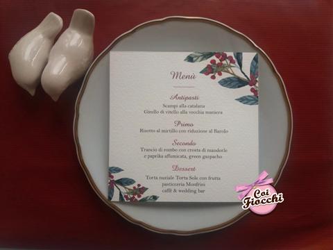 menu per il matrimonio invernale con rametti di agrifoglio