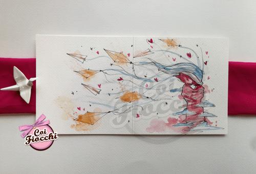 partecipazione ad acquerello con disegno romantico che raffigura il bacio di una coppia tra gli aquiloni