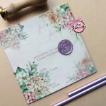 partecipazione nozze con ceralacca e fiori in carta trasparente
